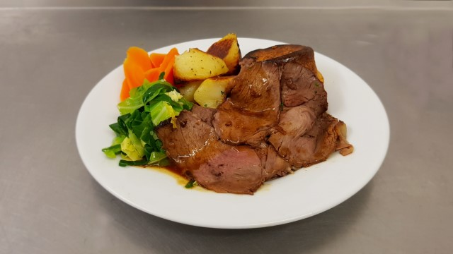 Roast beef and Yorkshire pudding, roast potatoes and mixed vegetables